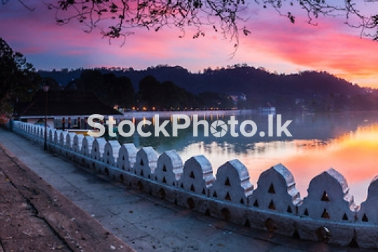 Sunrise panoramic photo of Kandy Lake and the Clouds Wall (Walak